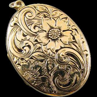 Vintage ornate chased floral engraved gold filled locket signed JM Fisher Company