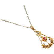 Tiny antique Edwardian 10k yellow and green gold filigree ruby lavalier pendant necklace