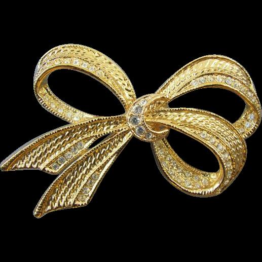Vintage gold tone rhinestone crystal ribbon bow brooch pin signed Roman