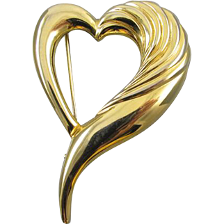Vintage gold tone asymmetrical witches heart brooch pin