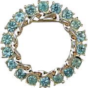 Vintage silver tone blue rhinestone crystal wreath circle brooch pin