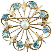 Vintage Retro Moderne 14k gold 2.65 carats of genuine blue zircon and cultured pearl brooch pin signed Binder Brothers, INC.