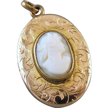 Antique Edwardian gold filled chased pink shell cameo locket signed Wolcott MFG CO