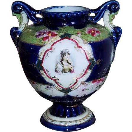 Stunning hand painted Austrian cobalt blue glaze princess in tiara crown and roses ceramic porcelain eared footed urn vase