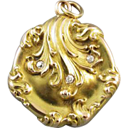 Stunning antique Edwardian Art Nouveau 10k gold diamond heptagon locket with heavy repousse clamshell and ocean waves design