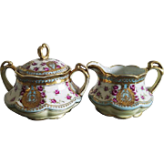 Antique Nippon Japan hand painted porcelain ceramic lidded sugar and creamer / eared with handles