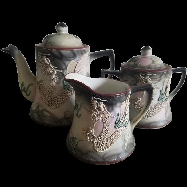 Antique Nippon Japan Satsuma Moriage Dragonware hand painted porcelain ceramic lidded sugar, creamer and lidded tea pot