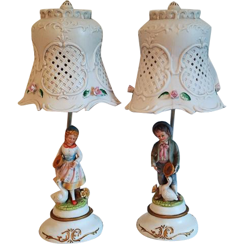 Pair of vintage ceramic bisque figural lattice work hand painted boy and girl with geese and pie lamps French Provincial