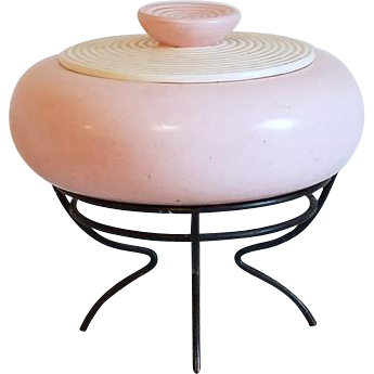 Vintage mid century retro moderne space age pink ceramic flying saucer covered bowl on black metal footed stand AC Davey California Pottery