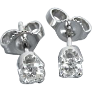 14k white gold .33 carat total weight SI1-SI2/J-K diamond solitaire pierced stud earrings