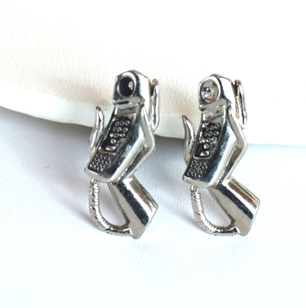 Vintage Corded Telephone and Hand Cufflinks