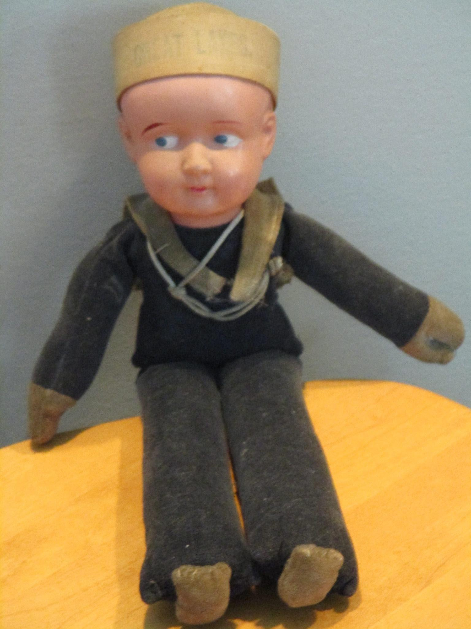 """13.5"""" Plastic  Sailor in Navy Marked Japan on tag and on cap Cap says Great Lakes"""