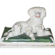 Small Staffordshire Figurine - Recumbent Mother Poodle with Three Puppies on a Cushion