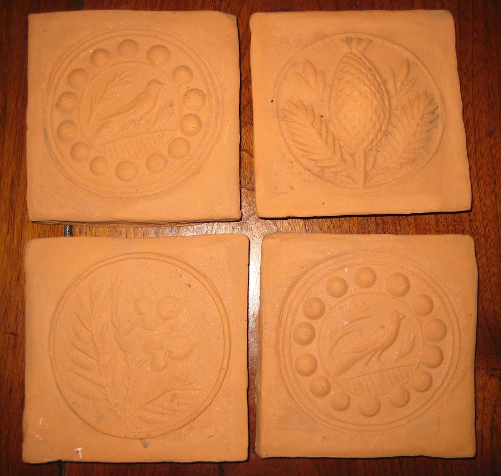 Four Bisque or Terra Cotta Tiles from Butter Molds