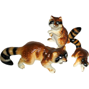 Set of Three Miniature Porcelain Raccoon Figurines