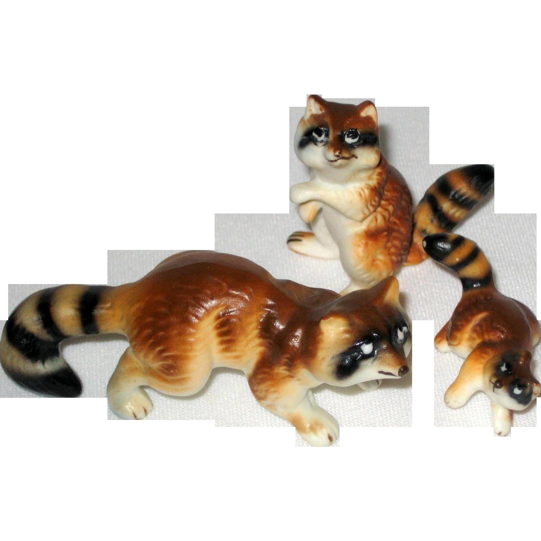 Set of Three Miniature Porcelain Raccoon Figurines