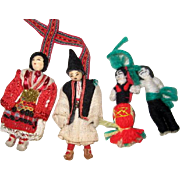 Two Pairs of Small Cloth and Yarn Dolls