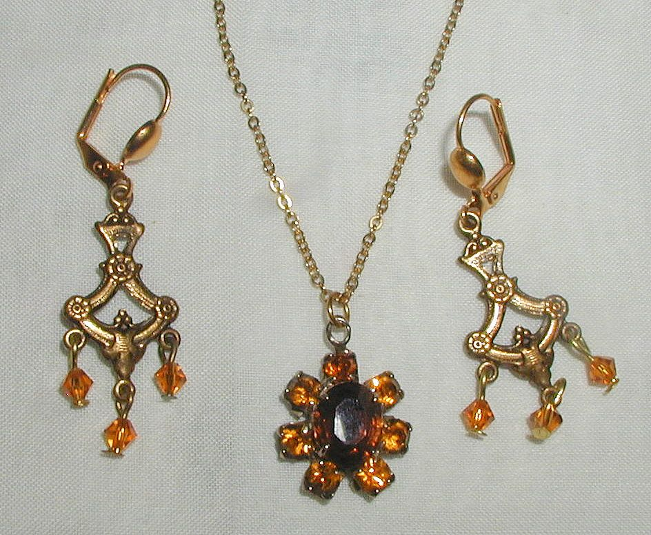 Necklace and Chandelier Style Earrings with Amber Colored Crystals