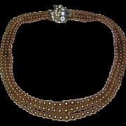 Tan or Golden Colored Three Strand Costume Pearl Necklace with Diamante Clasp - Circa 1940
