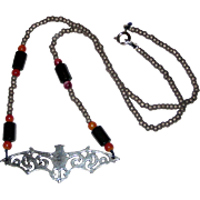 "Beaded Bat Necklace in Black, Orange and Bronze - 19"""