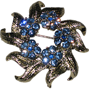 Silver-tone Wreath Brooch with Bright Blue Rhinestone Flowers