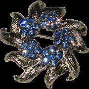 Silver-tone Wreath Brooch with Bright Blue Rhinestone Flowers