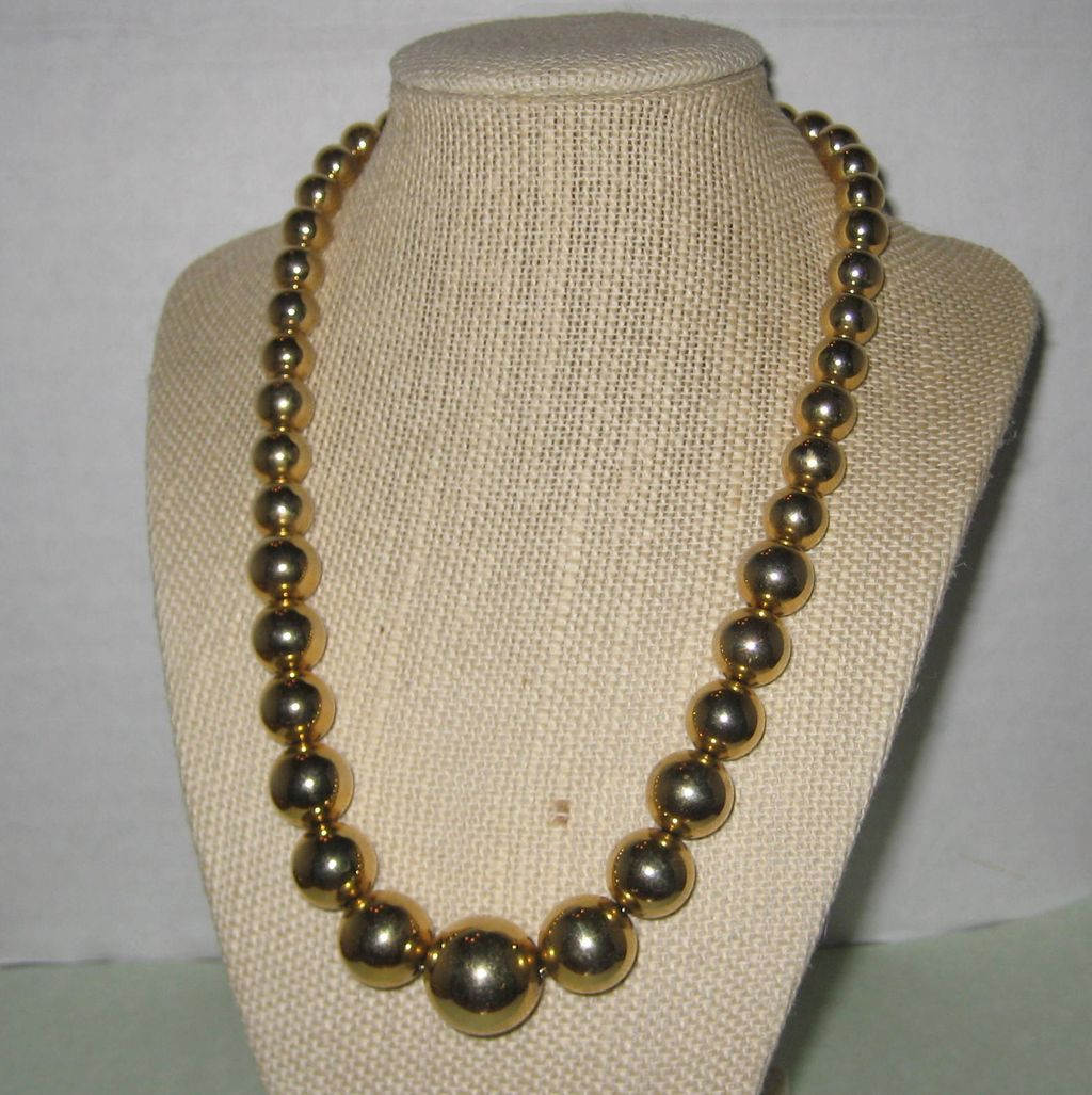 Gold-tone Graduated Bead Necklace - Signed Deja