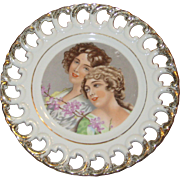 Cabinet or Wall Plate with Two Lovely Girls and Reticulated Edge