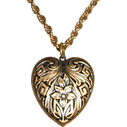 Gold-tone Pendant Necklace with Embossed Floral Heart