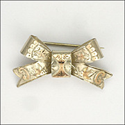 English 1902 Sterling Silver and 9k Gold Overlay Bow Pin