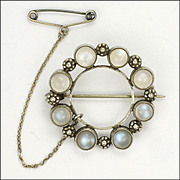Arts & Crafts Moonstone and Silver Circle Pin