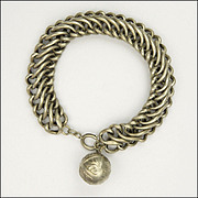 French Circa 1900 Silver Engraved Supple Link Bracelet with Ball Charm