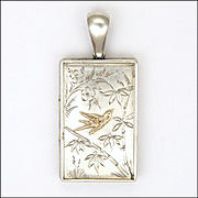 Victorian Aesthetic Locket in Sterling Silver with Gold Overlaid Bird - 1880