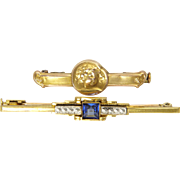 A Pair of French Gold Filled Pins FIX and ORIA