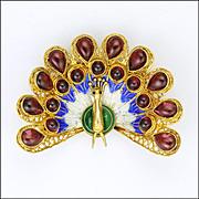 Gold Washed Silver Enamel and Natural Garnets Peacock Brooch