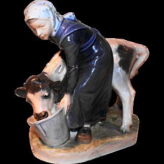 Royal Copenhagen Figurine #779 Girl Feeding Calf