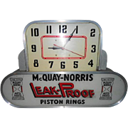 McQuay-Norris Leak-Proof Piston Rings Lighted Clock