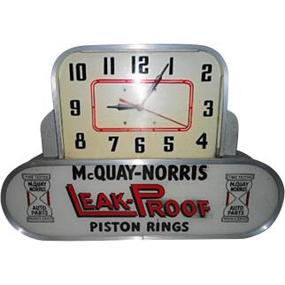 McQuay-Norris Leak-Proof Piston Rings Lighted Clock
