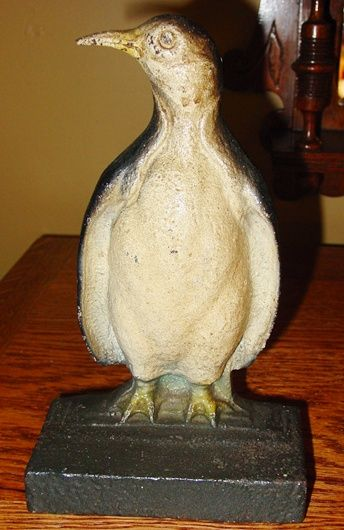 Vintage cast iron door stop Penguin