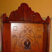 Hanging walnut corner cabinet with ladies head