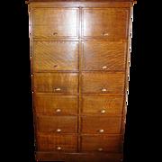 Unusual quartered oak 12 door office file type cabinet