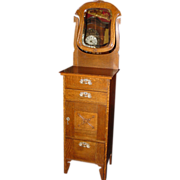 Unusual quartered oak shaving stand with shoe shine drawer