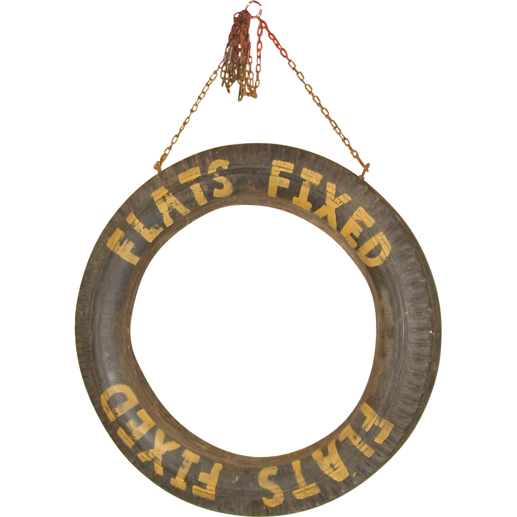 Early car tire with 'FLATS FIXED' painted on it--service station advertisement