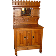 Unusual quartered oak parlor ice box with spigot