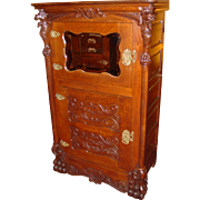 Impressive oak parlor ice box with Griffin guardians