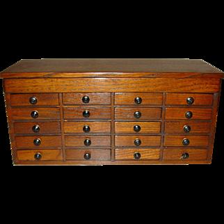 Neat oak 20 drawer jewelers  case cabinet