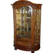 Exceptional Quartered oak curved glass china cabinet