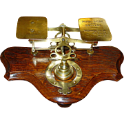 Brass & oak postal letter desk scale with nested weights