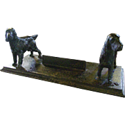 Cast iron dog boot scraper---signed
