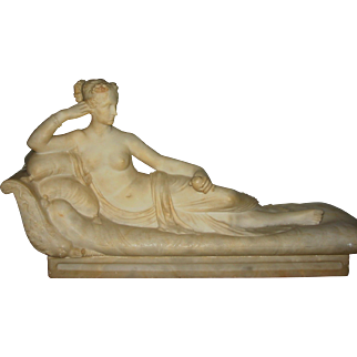 Fine antique alabaster lady on recamier holding fruit